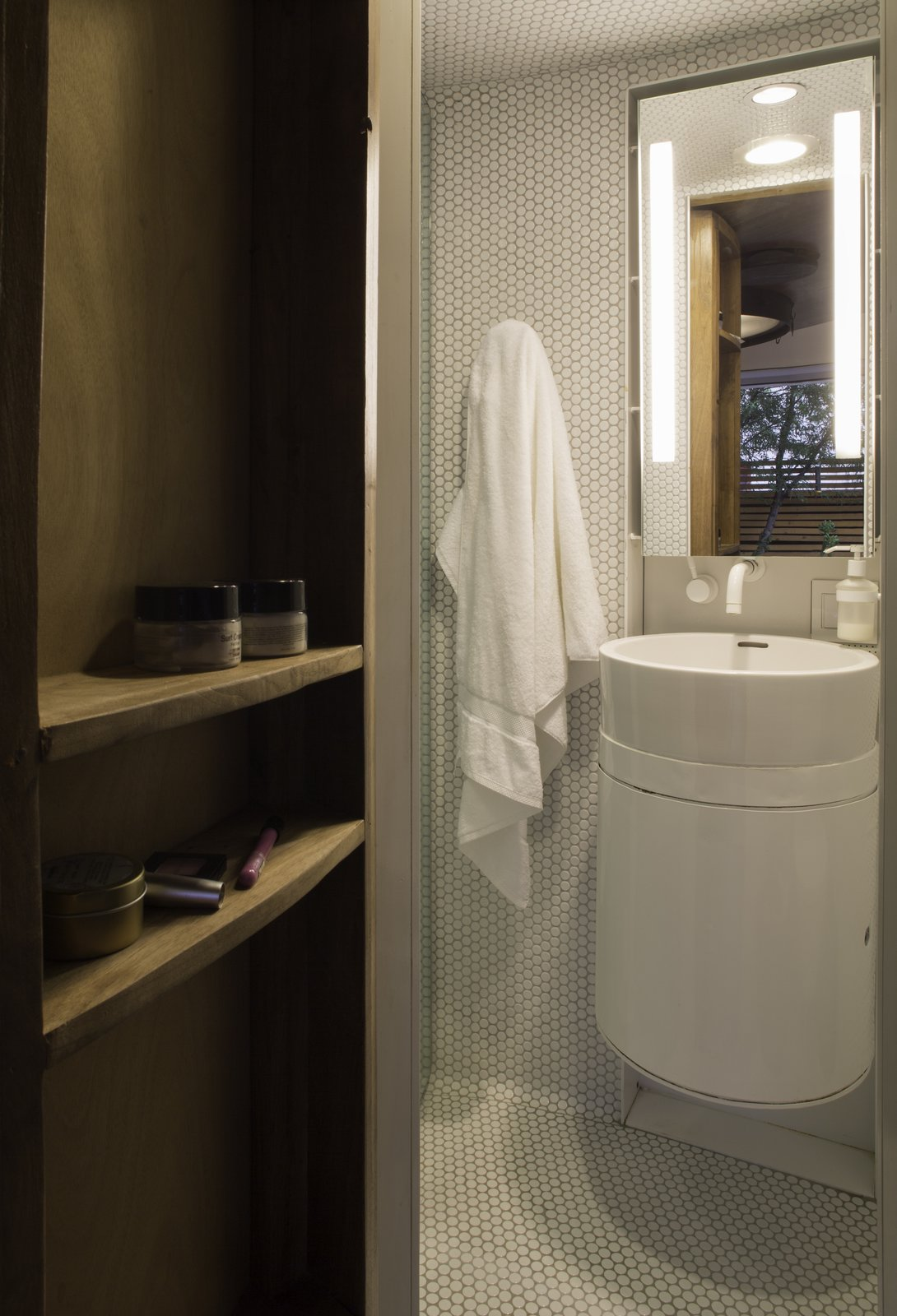 Bath, Ceiling, Vessel, Wall, and Mosaic Tile The ergonomic bath was intentionally designed with an outdoor shower to maximize square footage inside the silo house.  Best Bath Mosaic Tile Ceiling Photos from An Old Grain Silo Makes an Enchanting Tiny Home in Phoenix