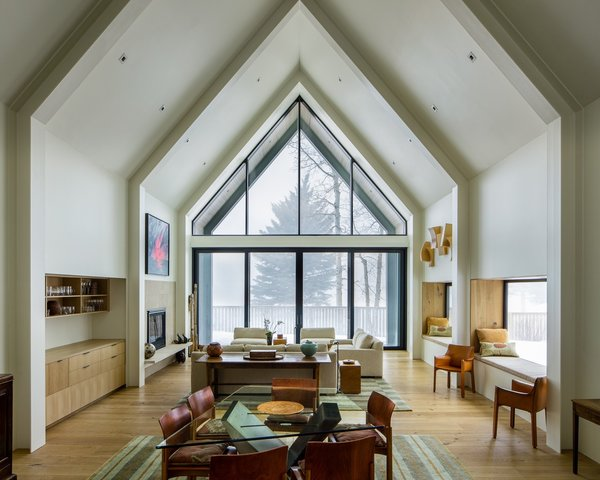 Designed by Studio B Architecture + Interiors, this modern farmhouse in Aspen allows a couple's art collection to shine with understated finishes and materials. Views and natural light were maximized via large spans of glass to instill a sense of airiness while the same wood used throughout the home added warmth. The minimalist interiors provide a muted canvas for their artifacts collected from travels to Africa and Indonesia, and art which includes 8-foot wooden sculptures, baskets from around the world, and Native American pieces including from R.C. Gorman.