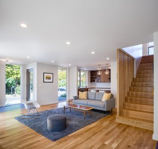 """""""The home functions in the way we live. We're able to take advantage of entertaining, and our youngest can even sprint through the home,"""" said Loosemore. The remodel also allowed them to reduce artificial light, as the open space and large windows allow in much more natural light."""