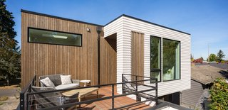 """Loosemore says, """"Being in a small house with kids and a dog, it's hard to find places of tranquility."""" The solution: a private deck off the master bedroom."""