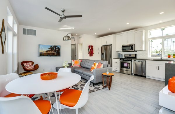 "Pictured is the largest of the units, the ""not-so-tiny home."" Its two bedrooms anchor each end of the home, offering privacy. The homes feature 9-foot ceilings, and this unit can accommodate a king-sized bed."