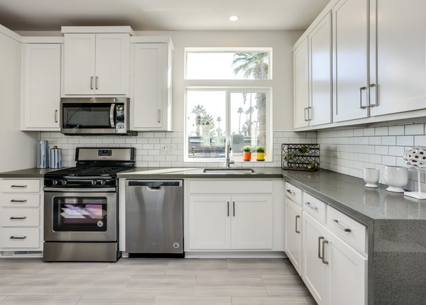 Kitchens range from compact, galley kitchens to open plans like the one above in the larger of the four units at Palm Canyon Mobile Club.