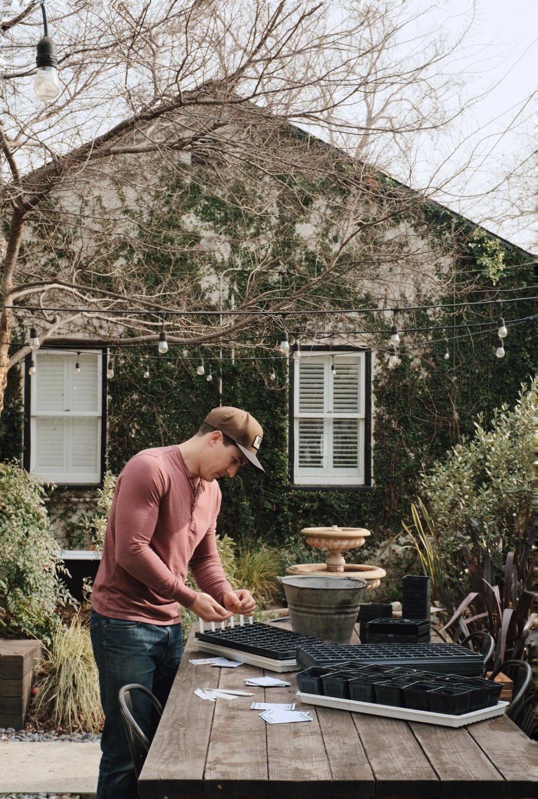 """When starting from seeds, Kyle Hagerty from Urban Farmstead suggests a variety of simple, DIY methods. """"Some use egg cartons, some people use plastic Solo Cups, paper pots out of newspaper, or used egg shells,"""" he says. """"But at most nurseries or hardware stores—and of course online—you can order seedling germination containers or trays.""""  Photo 1 of 9 in The Beginner's Guide to Starting Vegetable Seeds Indoors"""