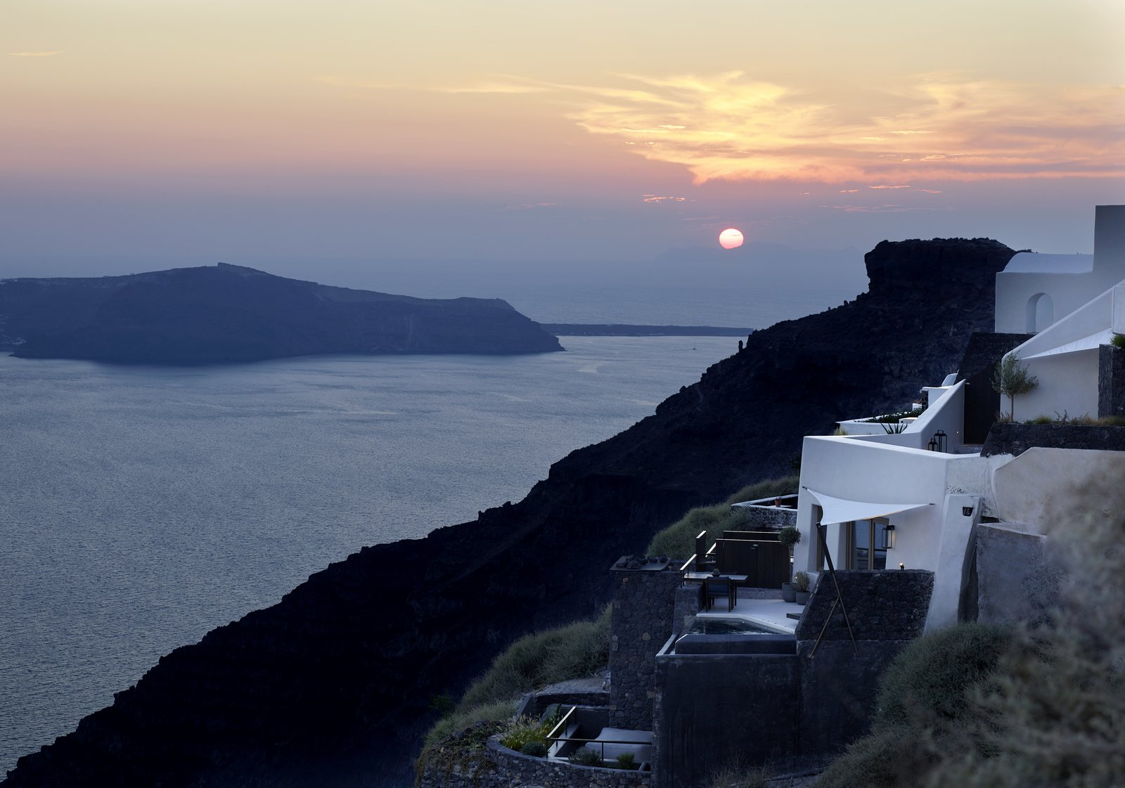 """""""If you look at it from a profile view, then you see that the building is like a part of the mountain,"""" says Bellonias.  Photo 10 of 10 in These Dreamy Villas on Santorini Take Inspiration From Traditional Cave Dwellings"""