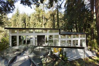 Fully renovated, Capilano House is a west coast modern home overlooking Capilano River in North Vancouver by Miza Architects.