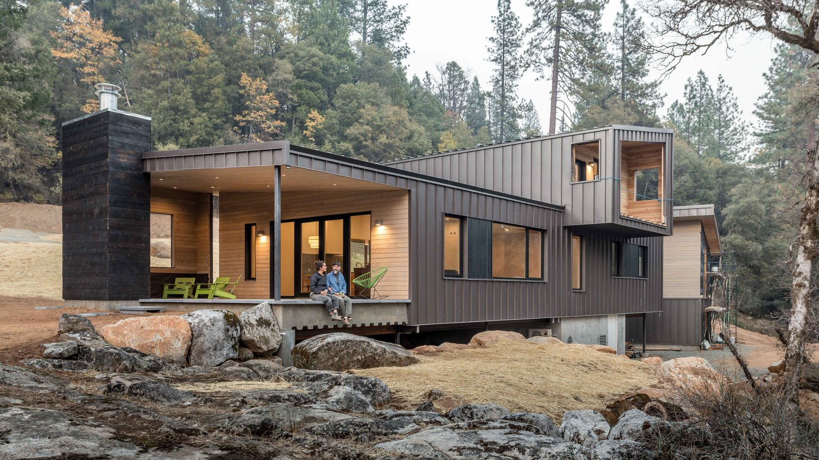 Exterior, Metal Roof Material, House Building Type, Wood Siding Material, Shed RoofLine, and Metal Siding Material Exterior view with designer and builder ... before the house was 100% completed  Best Photos from Good Haus