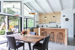 The opening from the kitchen/dining area to the outside was expanded with a bifold door.