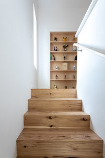 The petite addition houses two office spaces on the second floor, one tucked away behind a hidden bookcase door.