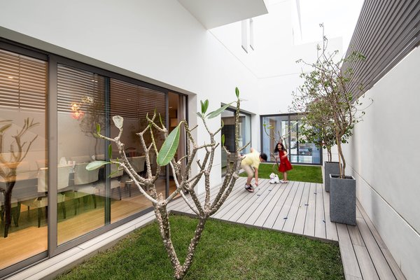 Outdoor, Garden, Grass, Shrubs, Trees, Gardens, Raised Planters, Flowers, Small, Wood, Metal, Planters, Horizontal, Concrete, Decking, Metal, and Landscape Private garden with deck  Best Outdoor Grass Horizontal Wood Photos from A House in Yarmouk