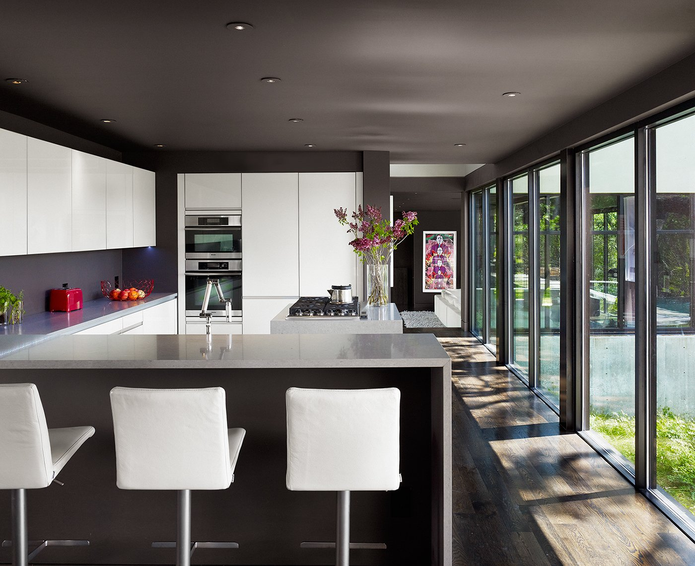 Kitchen, White Cabinet, and Dark Hardwood Floor Photographer: Casey Dunn  West Lake Hills Residence by Specht Architects