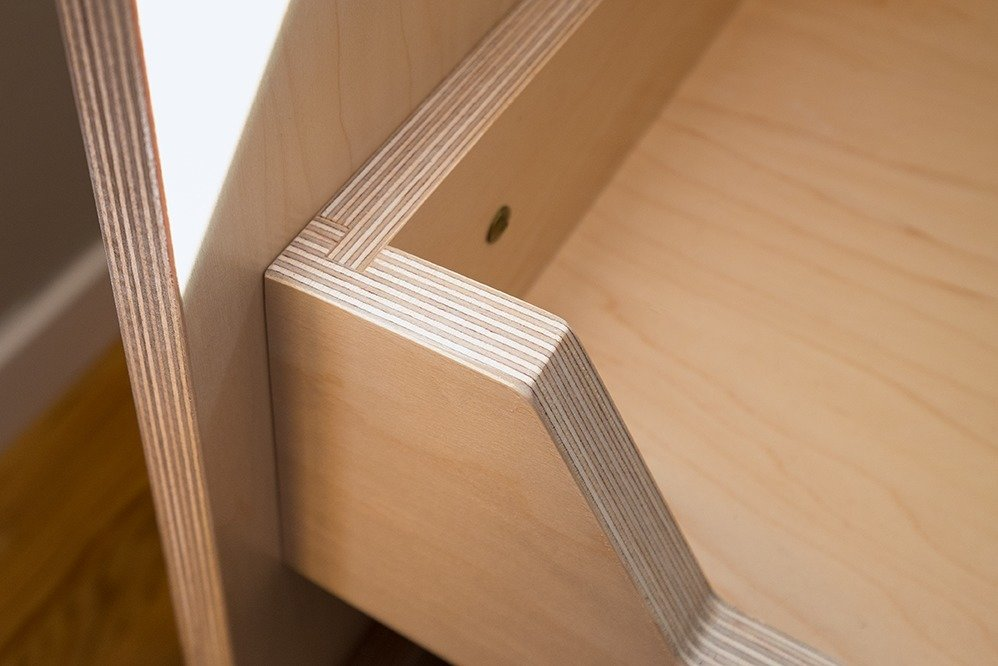 Laundry cabinets. Custom pull-out drawer with maple multi-ply. http://www.doolittledesign.com  Doolittle Design Co.