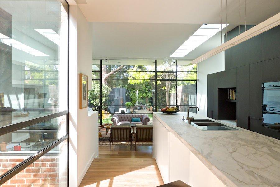 Kitchen, Marble Counter, White Cabinet, Pendant Lighting, and Medium Hardwood Floor Kitchen & Internal Courtyard  Best Photos from Residence K&S