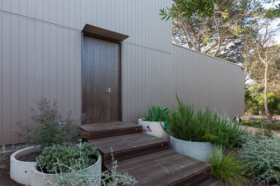 Entry Door Tagged: Outdoor, Trees, Decking Patio, Porch, Deck, Shrubs, Side Yard, and Raised Planters.  Residence J&C by Open Studio Pty Ltd Architecture