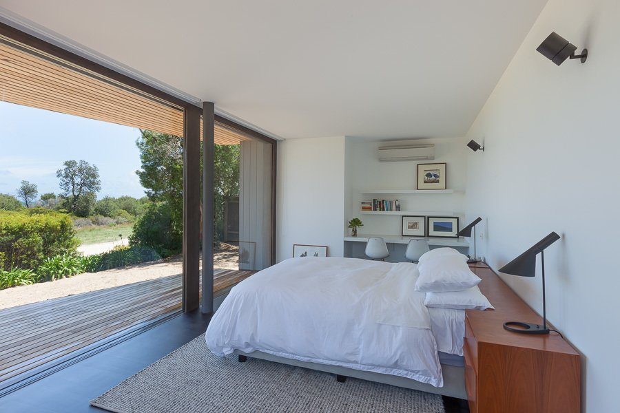 Bedroom, Bed, and Dark Hardwood Floor Bedroom & Ground Floor Deck  Residence J&C by Open Studio Pty Ltd Architecture