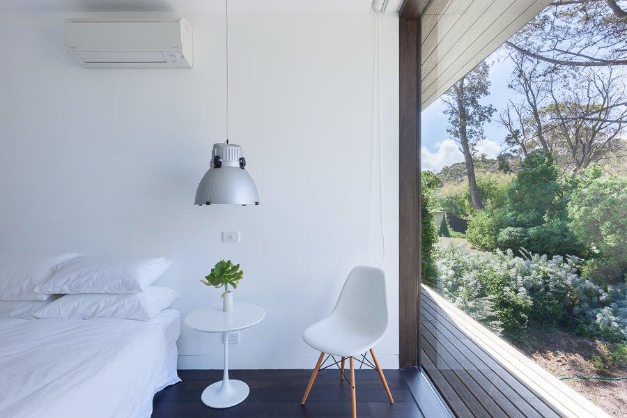 Bedroom, Bed, Dark Hardwood Floor, and Pendant Lighting Guest Bedroom  Residence J&C by Open Studio Pty Ltd Architecture