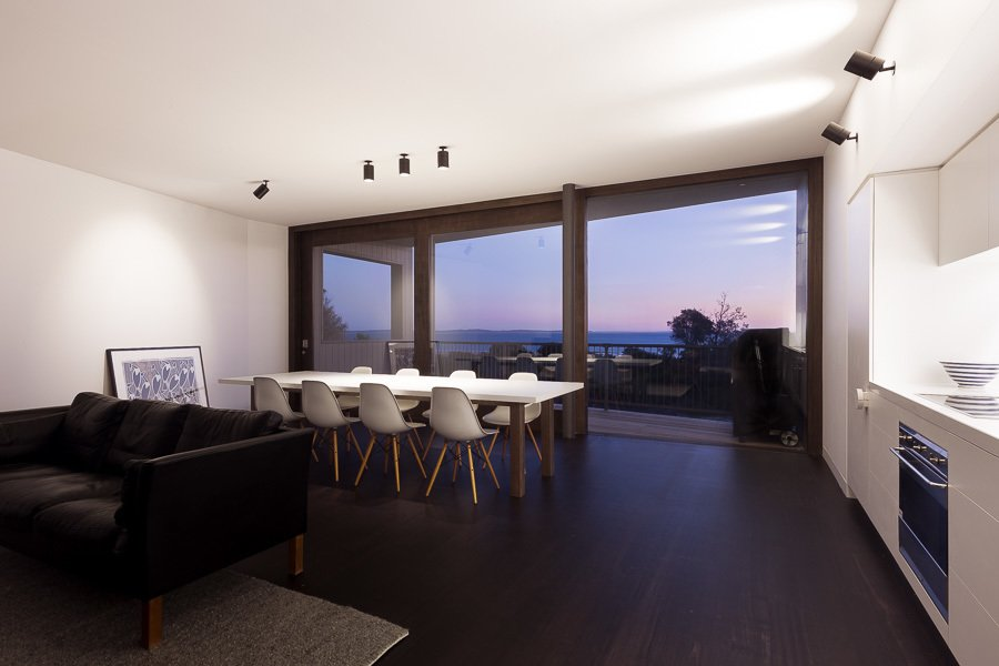 Living Room, Dark Hardwood Floor, and Accent Lighting Living Room at Dusk  Residence J&C by Open Studio Pty Ltd Architecture