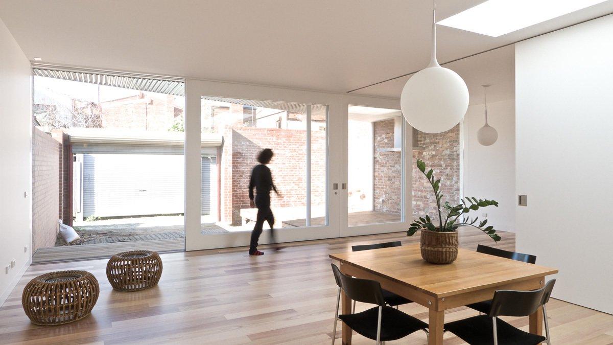 Living Room, Pendant Lighting, and Medium Hardwood Floor Glazed Sliding Doors  Residence L&N by Open Studio Pty Ltd Architecture
