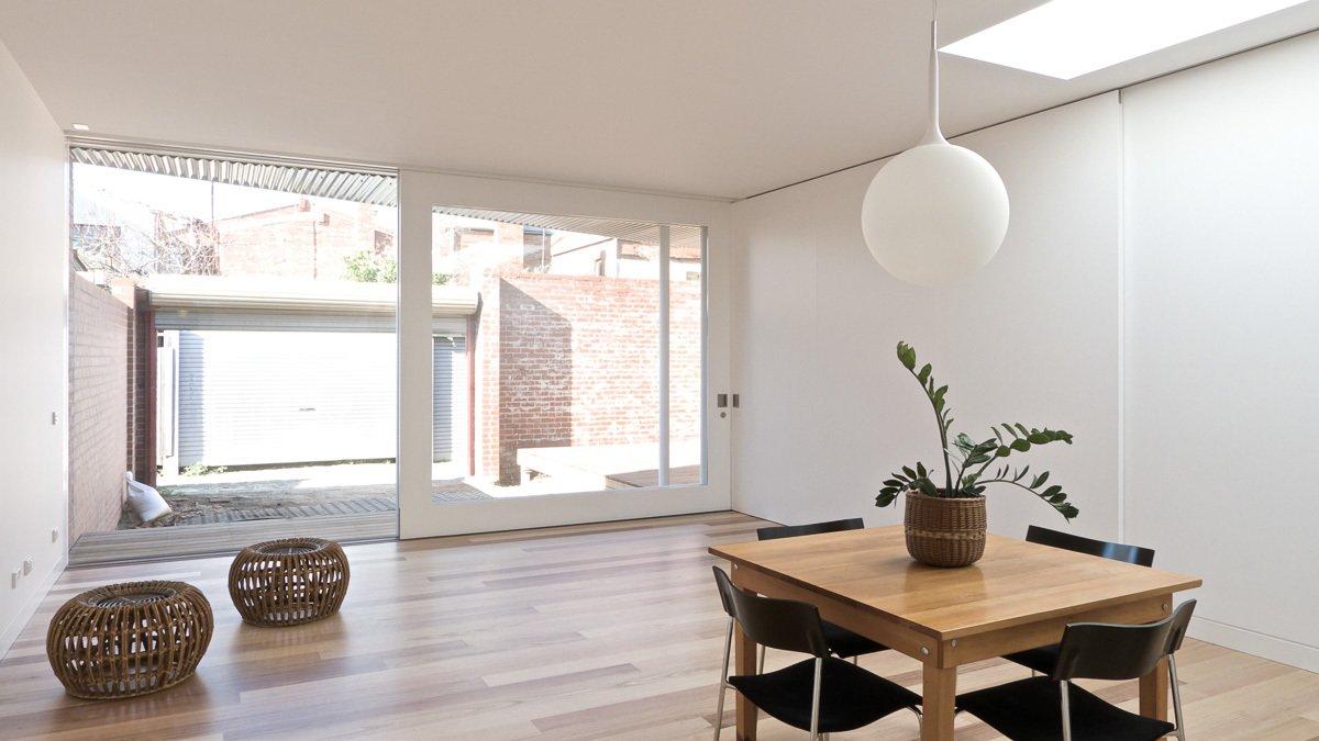 Living Room, Pendant Lighting, and Medium Hardwood Floor Sliding Wall  Residence L&N by Open Studio Pty Ltd Architecture
