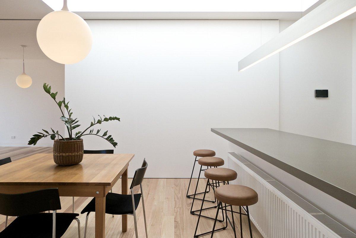 Kitchen, Medium Hardwood Floor, White Cabinet, Engineered Quartz Counter, and Pendant Lighting Kitchen & Dining  Residence L&N by Open Studio Pty Ltd Architecture