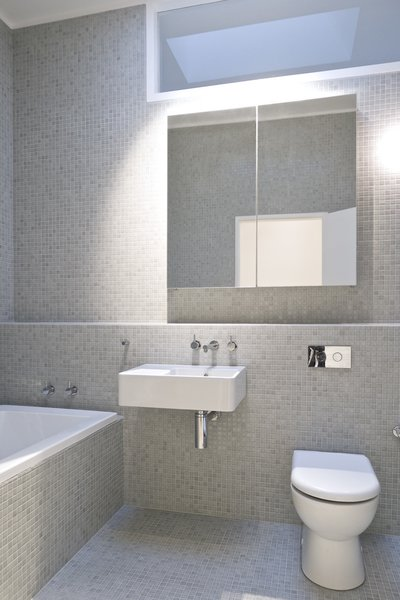 Bath Room, Tile Counter, Wall Mount Sink, Ceiling Lighting, Glass Tile Wall, Open Shower, Drop In Tub, and One Piece Toilet Bathroom  Residence L&N by Open Studio Pty Ltd Architecture