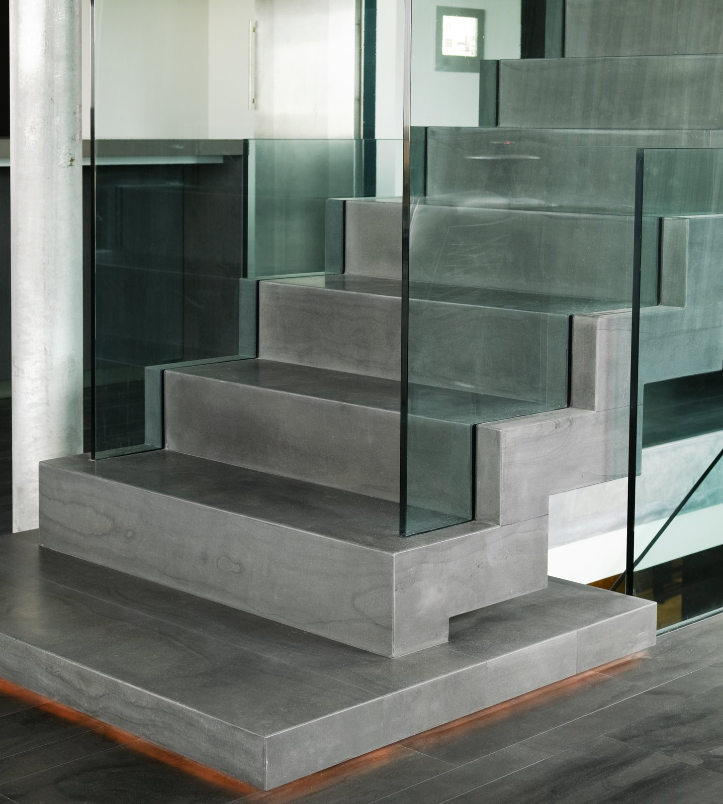 """staircase covered with the icelandic natural stone """"blagryti"""" (bluestone)  Casa G by Gudmundur Jonsson Architect"""