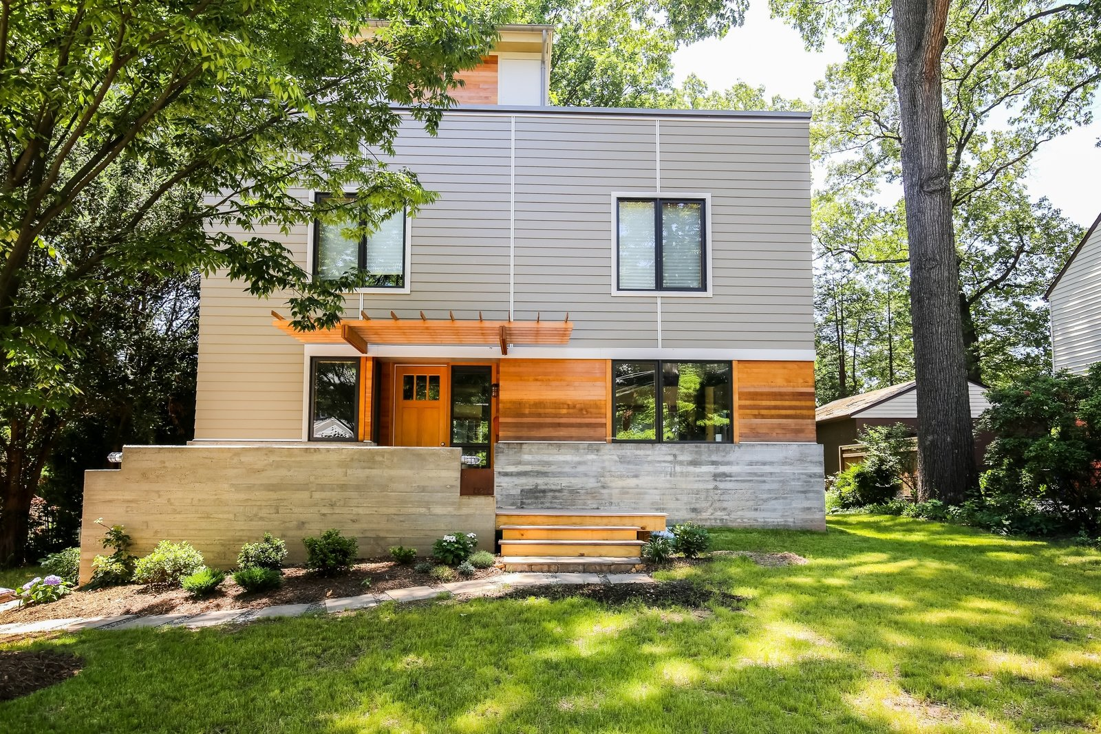 Outdoor white(out) house: keeping within the footprint of the modest colonial that once stood here, the new home is certified green by the county of Arlington, VA.  white(out) house