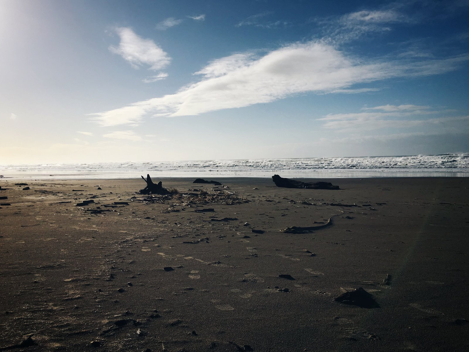 Footsteps in the sand. Neskowin, OR.  Photo 2 of 3 in Finding Lagom
