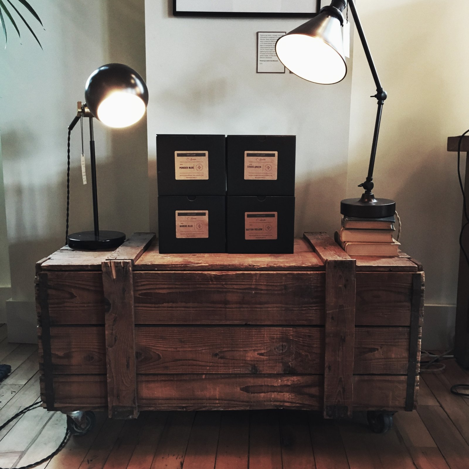 Lamps and an old create make for a stunning living room piece.  Schoolhouse Electric by Jonathan Simcoe