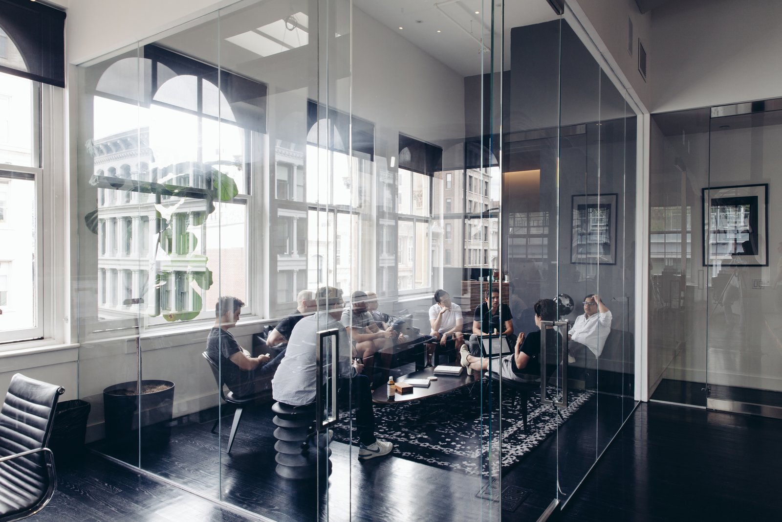 A corner meeting room is walled in by meters of glass.  Photo 1 of 1 in Discuss: What Movements in Interior Design Do You See Gaining Speed This Spring?