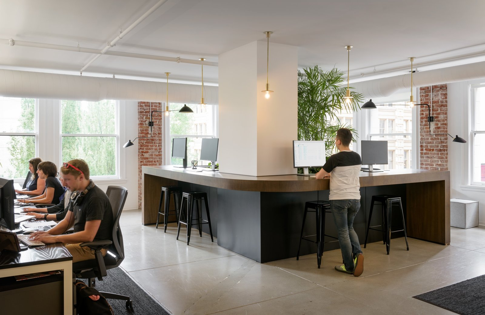 Large standing spaces in common areas is a newer trend in office spaces but allows employees to work in the way that is best suited to them.  Photo 4 of 12 in Step Inside Squarespace's Minimalist Portland Office