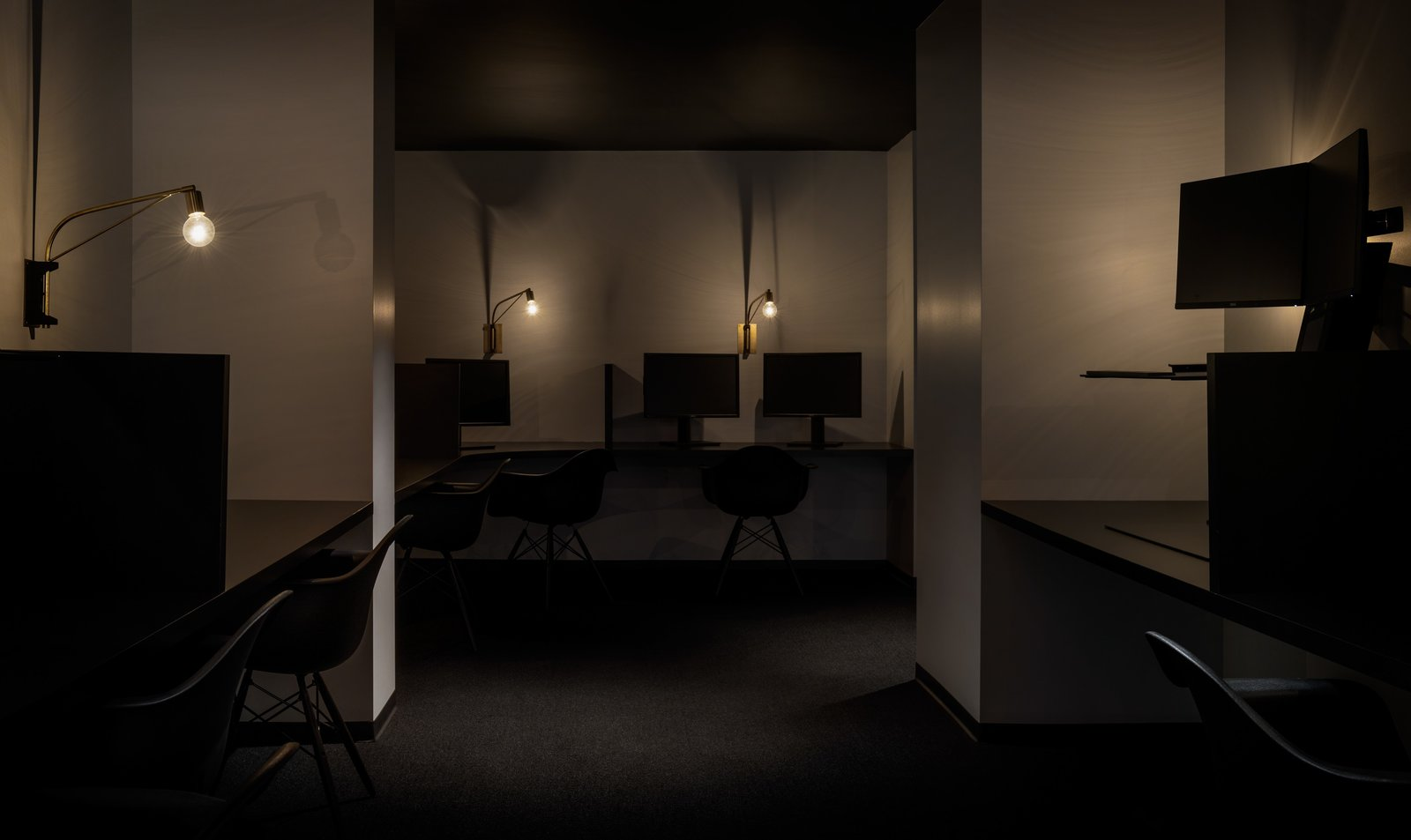 These dimly lit private workspaces offer a way for employees to find focus and heads-down time away from the bustle of larger open spaces.  Photo 6 of 12 in Step Inside Squarespace's Minimalist Portland Office
