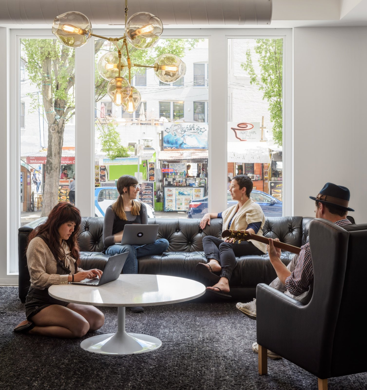 Well-designed spaces are all about people—creating places for co-workers to connect and be the best versions of themselves.  Photo 12 of 12 in Step Inside Squarespace's Minimalist Portland Office
