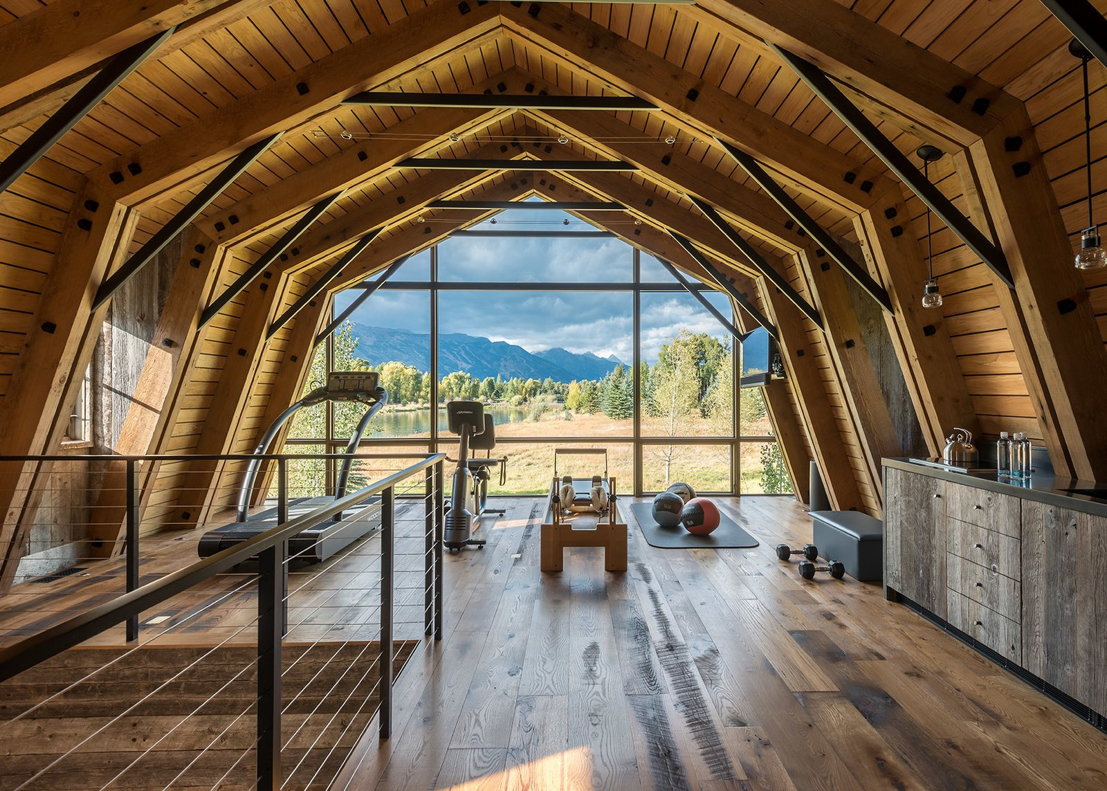Windows, Wood, and Picture Window Type The extensive use of natural wood on nearly every surface makes the inside of The Barn feel like an extension of the landscape outside.  Photo 2 of 8 in A Guest Barn in Jackson, Wyoming, Fuses Modern and Rustic Elements
