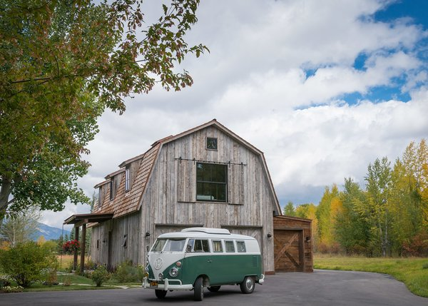 A classic VW bus in vintage colors shows both the scale and scope of The Barn and its surrounding scenery.