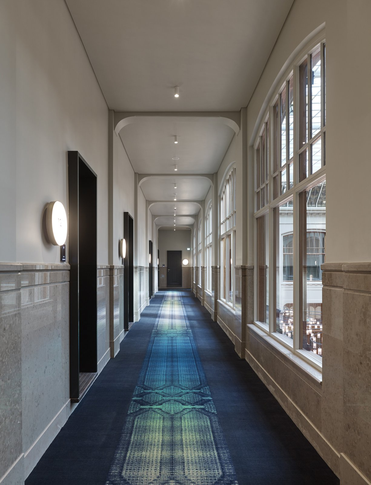 Hallway and Carpet Floor A long view down the corridor of the second floor.  Photo 8 of 14 in Formerly a Historic Bank, This Amsterdam Hotel Honors its Stately Roots