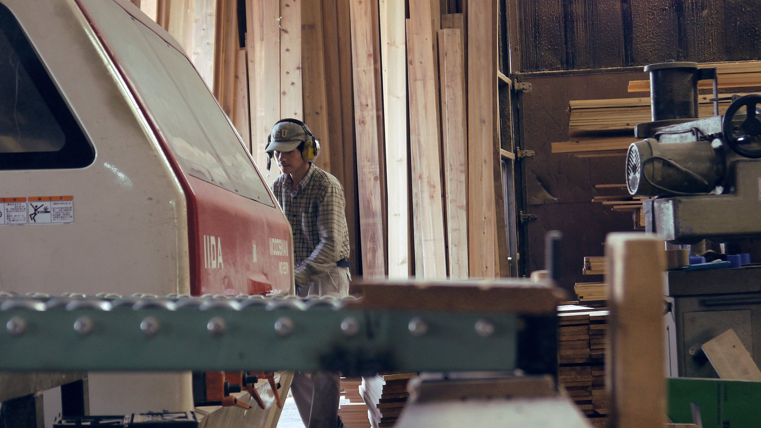 Workers prepare cedar planks for use in Yoshino Cedar House.  Photo 4 of 12 in The Community-Run Cedar House by Airbnb and Go Hasegawa Welcomes Guests in Rural Japan from Yoshino Cedar House