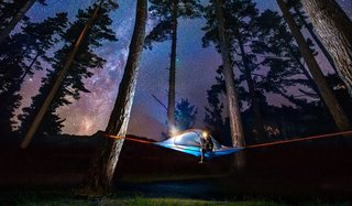 Sleeping suspended between trees is a sublime way to take in outdoor vistas in the summer.