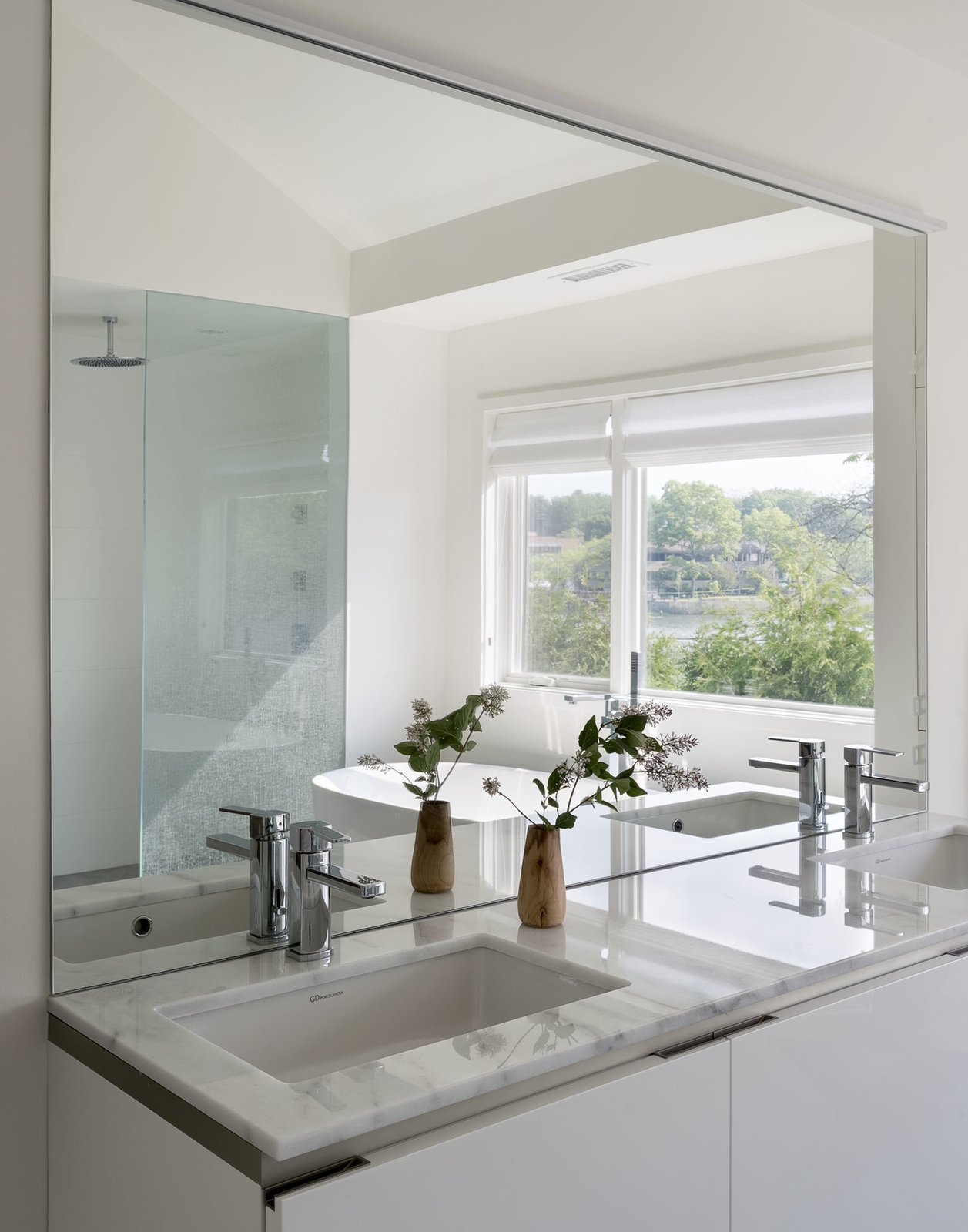 Bath Room, Engineered Quartz Counter, Porcelain Tile Floor, Drop In Sink, Open Shower, Recessed Lighting, Freestanding Tub, Wall Lighting, One Piece Toilet, and Porcelain Tile Wall Bathroom Detail  The River House by Sellars Lathrop Architects