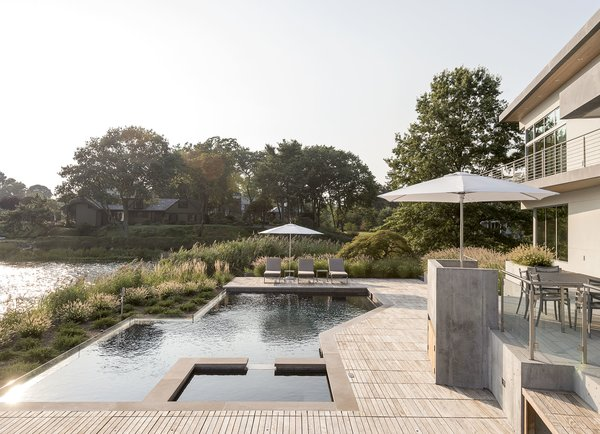 Long Island Sound House's pool and hot tub connect gracefully to an ipe terrace. Sellars Lathrop Architects designed the outdoor and indoor spaces with hurricane concerns in mind.