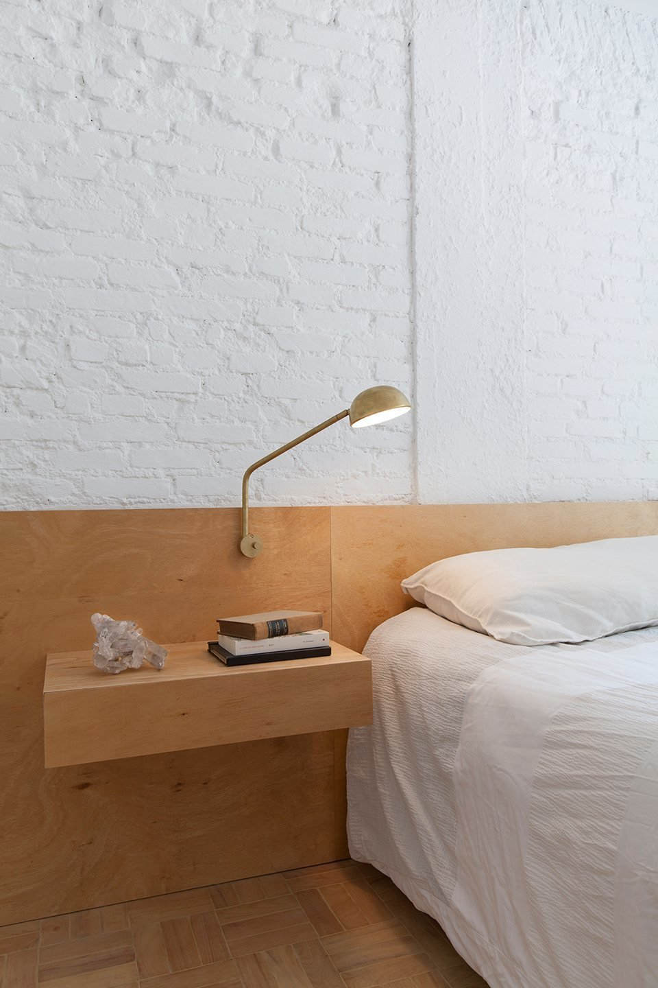 Bedroom, Medium Hardwood Floor, Night Stands, Bed, and Table Lighting Plywood headboard and floating nightstand. Ap Cobogó by Alan Chu. © Djan Chu.  upinteriors.com/go/sph59  Photos from Bolinas