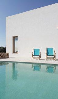 Mediterranean patio with pool. PI House by Munarq. © Adrià Goula.  upinteriors.com/go/sph419