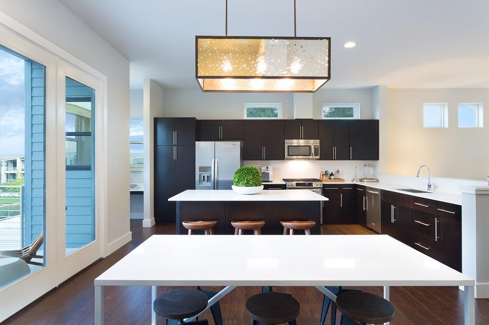Incorporating smart style. Kitchen, Denizen 04, Austin.  Millennial Housing Trends