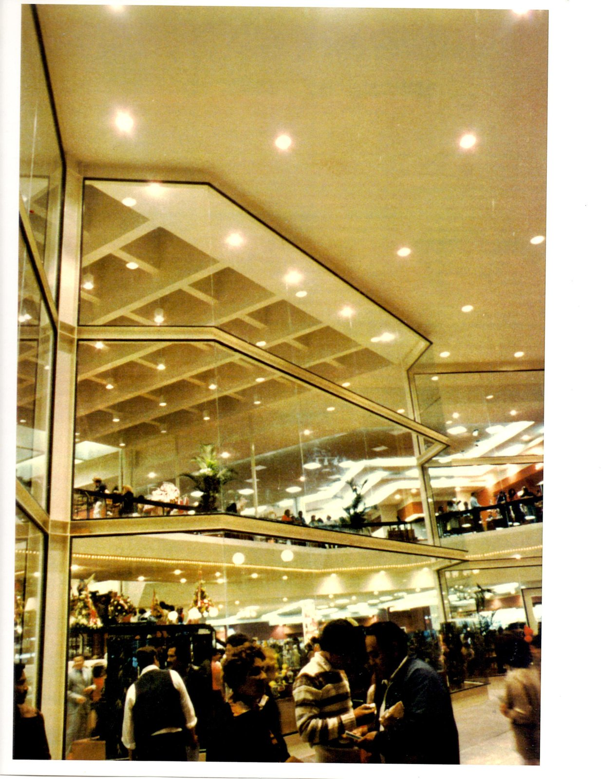 GALLERY PLAZA DEPARTMENT STORE Glass curtain wall served successfully as catalytic between exterior and interior activities at the store.  RETAIL STORES