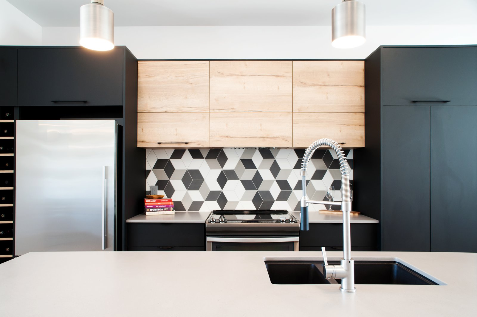 Kitchen with RIOBEL faucet and RAMACIERI SOLIGO tiles and CEASAR STONE quartz countertops and fridge by FISHER AND PAYKEL  Concept DUB House by Concept Dub