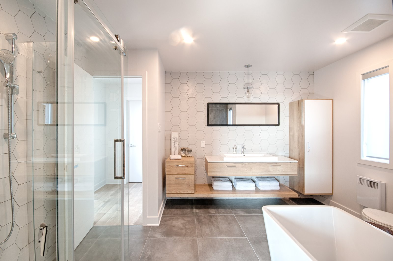 Bath Room, Engineered Quartz Counter, Ceramic Tile Floor, Freestanding Tub, Open Shower, and Ceramic Tile Wall Bathroom with hexagon tiles by ITAL NORD and miroir by IKEA  James house by Concept Dub