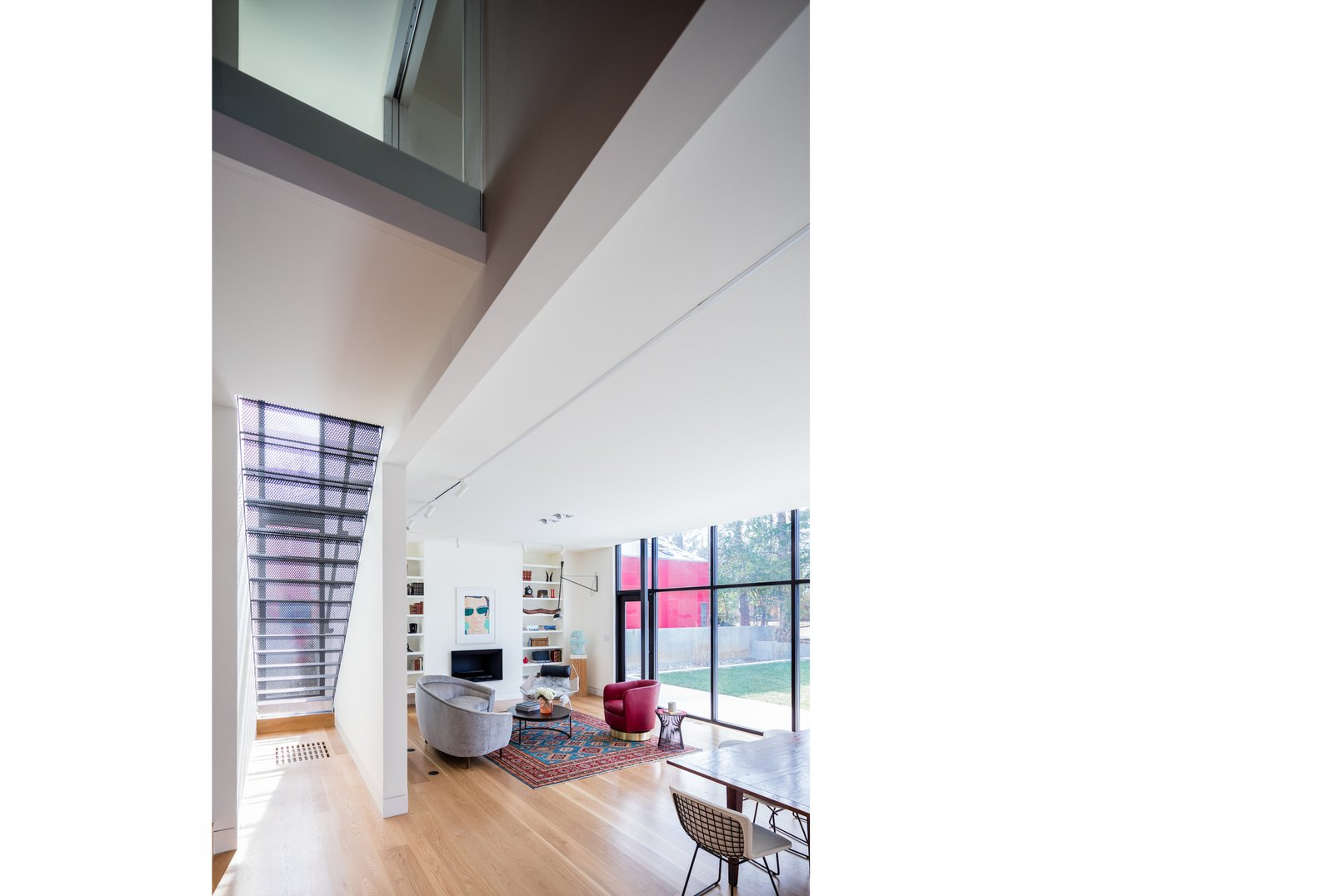 Hallway and Medium Hardwood Floor Double-height space serves as a transition between old and new.  Hillcrest House Addition: An Innovative Approach to Old + New