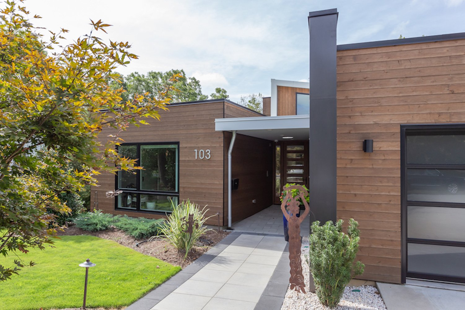 Exterior, House Building Type, Metal Roof Material, Flat RoofLine, Wood Siding Material, and Metal Siding Material The main entrance.  The Thomas Residence