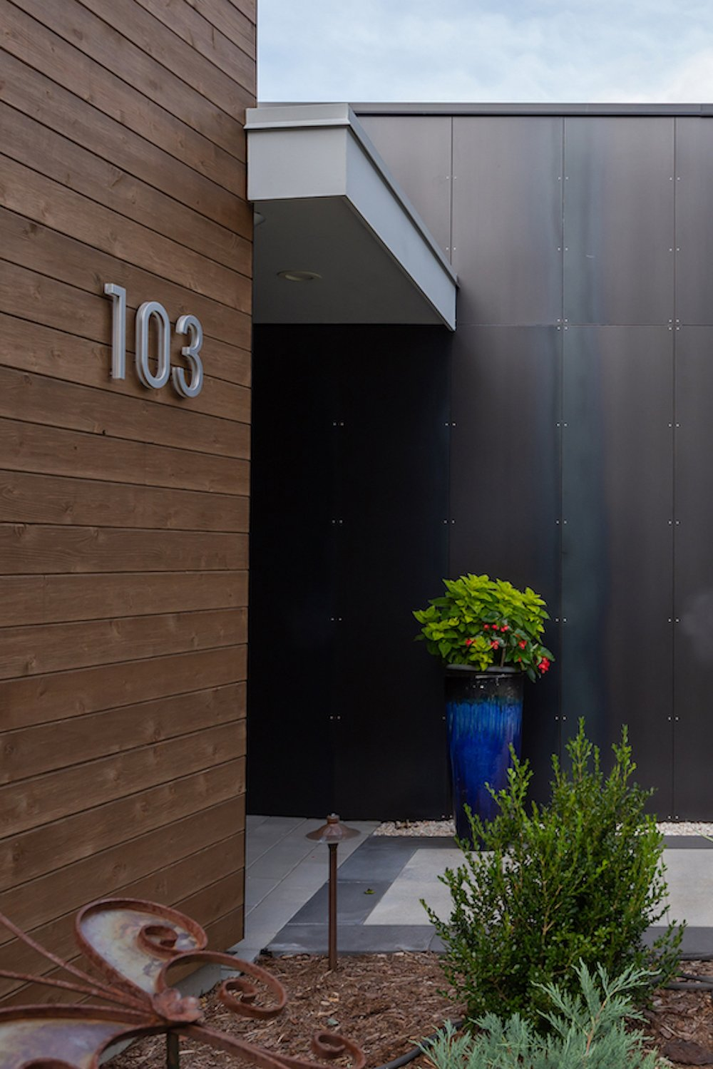 Exterior, Metal Roof Material, House Building Type, Wood Siding Material, Flat RoofLine, and Metal Siding Material Natural cedar is a warm counterpoint to the dramatic steel wall at the entrance.  The Thomas Residence