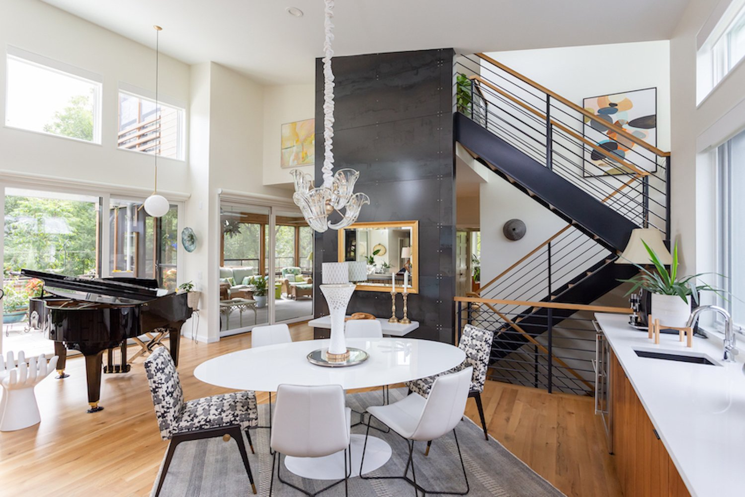 Dining Room, Chair, Table, Light Hardwood Floor, Storage, and Pendant Lighting Beyond the dining space, an open staircase provides vertical circulation.  The Thomas Residence