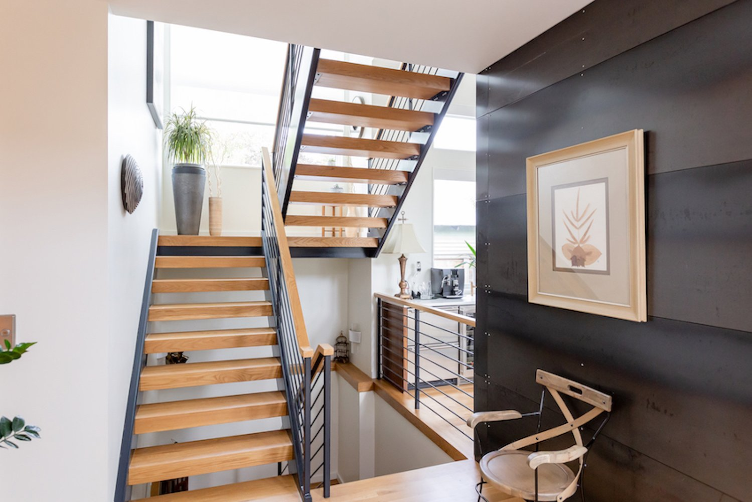 Staircase, Wood Tread, and Metal Railing The black steel and white oak on the staircase echo the white oak flooring and steel wall nearby.  The Thomas Residence